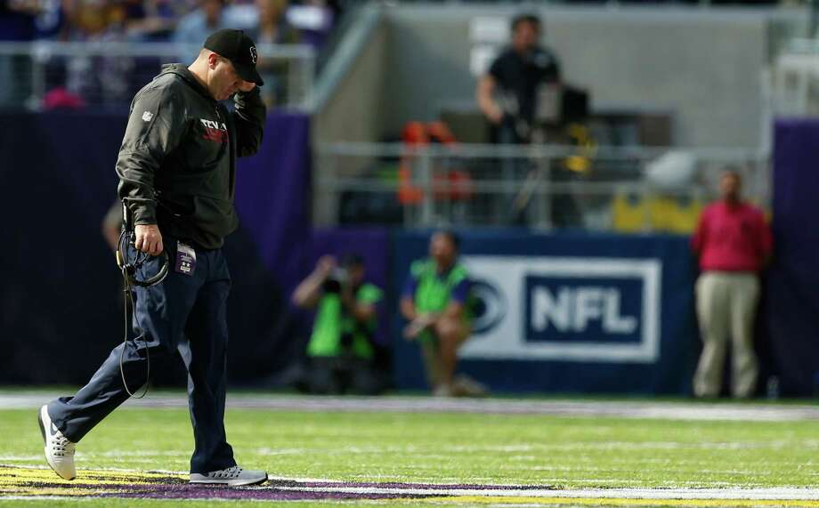 Houston Texans head coach Bill O'Brien walks off the field after checking on tight end Ryan Griffin, who was injured making a tackle on an interception by Minnesota Vikings strong safety Andrew Sendejo, during the third quarter of an NFL football game at U.S. Bank Stadium on Sunday, Oct. 9, 2016, in Minneapolis. Photo: Brett Coomer, Houston Chronicle / © 2016 Houston Chronicle
