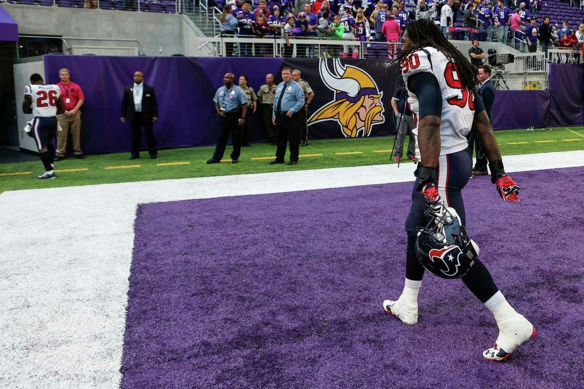 Houston Texans defensive end Jadeveon Clowney (90) walks off the field following the Texans loss to the Minnesota Vikings at U.S. Bank Stadium on Sunday, Oct. 9, 2016, in Minneapolis.