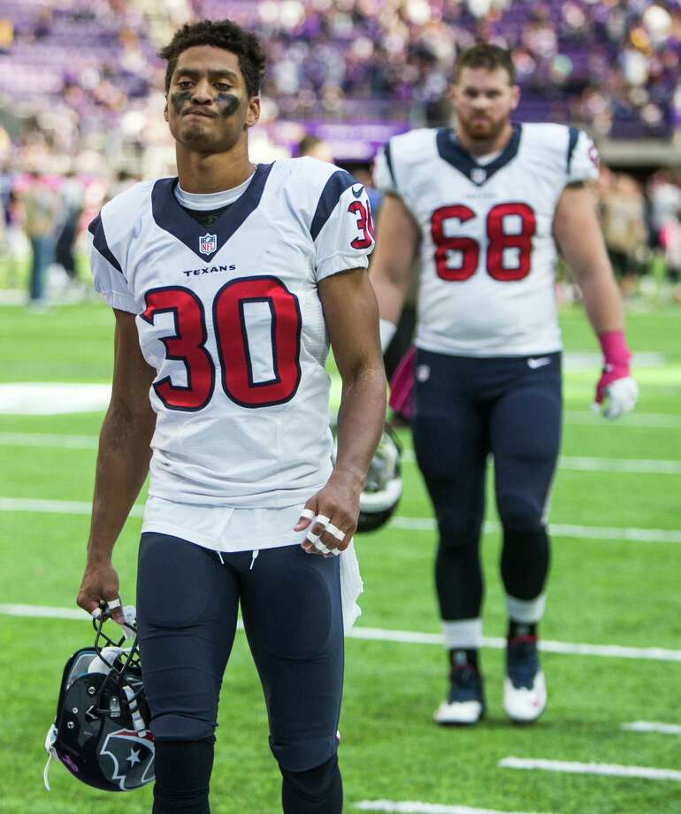 Houston Texans cornerback Kevin Johnson (30) and center Tony Bergstrom (68) walk off the field following the Texans loss to the Minnesota Vikings at U.S. Bank Stadium on Sunday, Oct. 9, 2016, in Minneapolis. Photo: Brett Coomer, Houston Chronicle / © 2016 Houston Chronicle