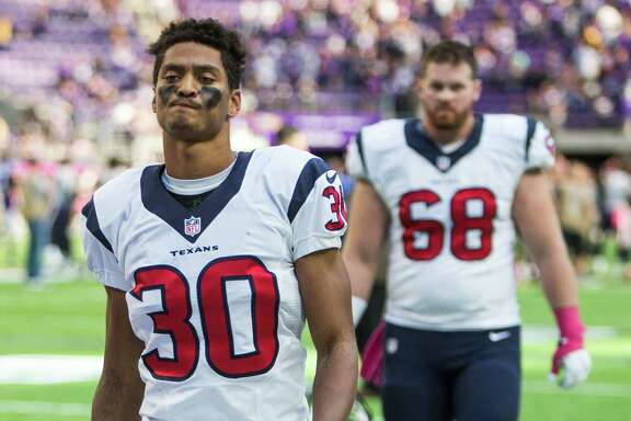 Houston Texans cornerback Kevin Johnson (30) and center Tony Bergstrom (68) walk off the field following the Texans loss to the Minnesota Vikings at U.S. Bank Stadium on Sunday, Oct. 9, 2016, in Minneapolis.