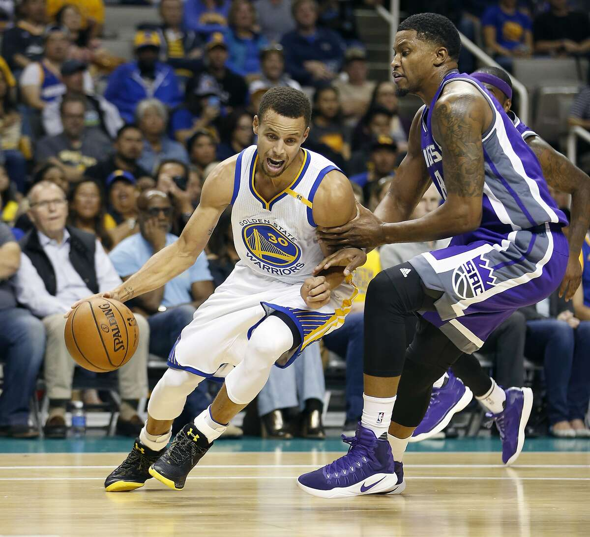 Golden State Warriors' Stephen Curry, left, drives to the basket against Sacramento Kings' Rudy Gay, right, during the first half of a preseason NBA basketball game Thursday, Oct. 6, 2016, in San Jose, Calif. (AP Photo/Tony Avelar)
