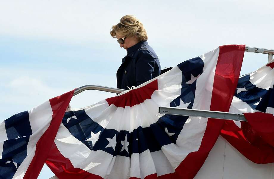 US Democrat presidential nominee Hillary Clinton arrives October 9, 2016 at Lambert-St. Louis International Airport in St. Louis, Missouri where she will take part in the second televised debate against her Republican rival Donald Trump at Washington University. Photo: TIMOTHY A. CLARY, AFP/Getty Images