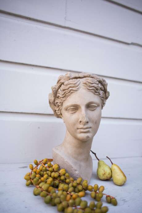 A bust with dates and pears makes a fall decoration in Julia Lake's front yard. Photo: Talia Herman
