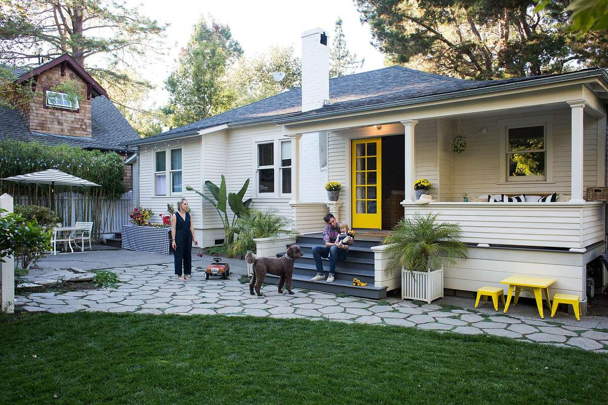 Julia Lake (left), her husband, son and dog in their front doorway of their small San Anselmo bungalow.