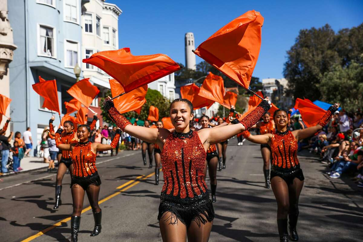 Flag captain Angelica Terriquez (center), performs during the Italian Heritage parade, in San Francisco, California, on Sunday, Oct. 9, 2016.