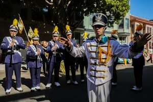 Drum major Max Loth leads his fellow musicians and schoolmates, from Ygnacio Valley High school, ahead of the Italian Heritage parade, in San Francisco, California, on Sunday, Oct. 9, 2016.