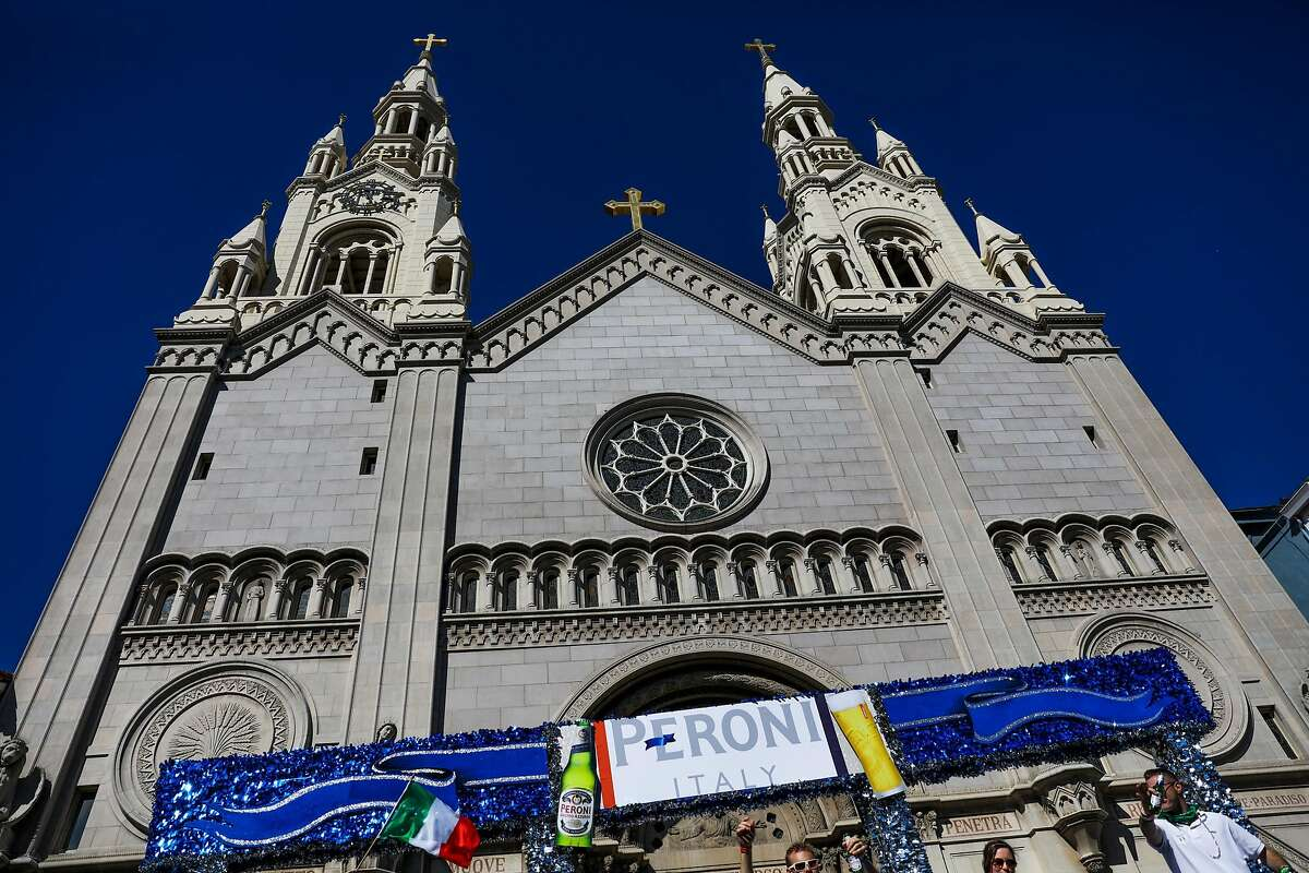 A Peroni float rides by St.Peter and Paul Church during the Italian Heritage parade, in San Francisco, California, on Sunday, Oct. 9, 2016.