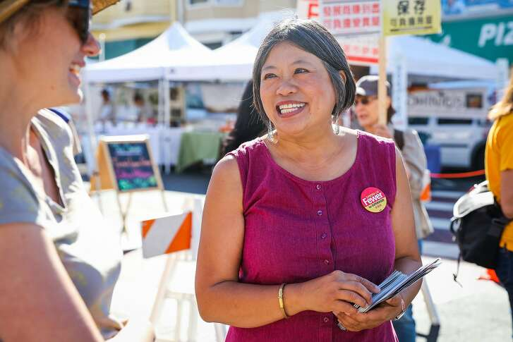 Sandra Fewer, who is running for District 1 Supervisor chats with local Corey F. (left) during the Clement Street farmers market, in San Francisco, California, on Sunday, Oct. 9, 2016.