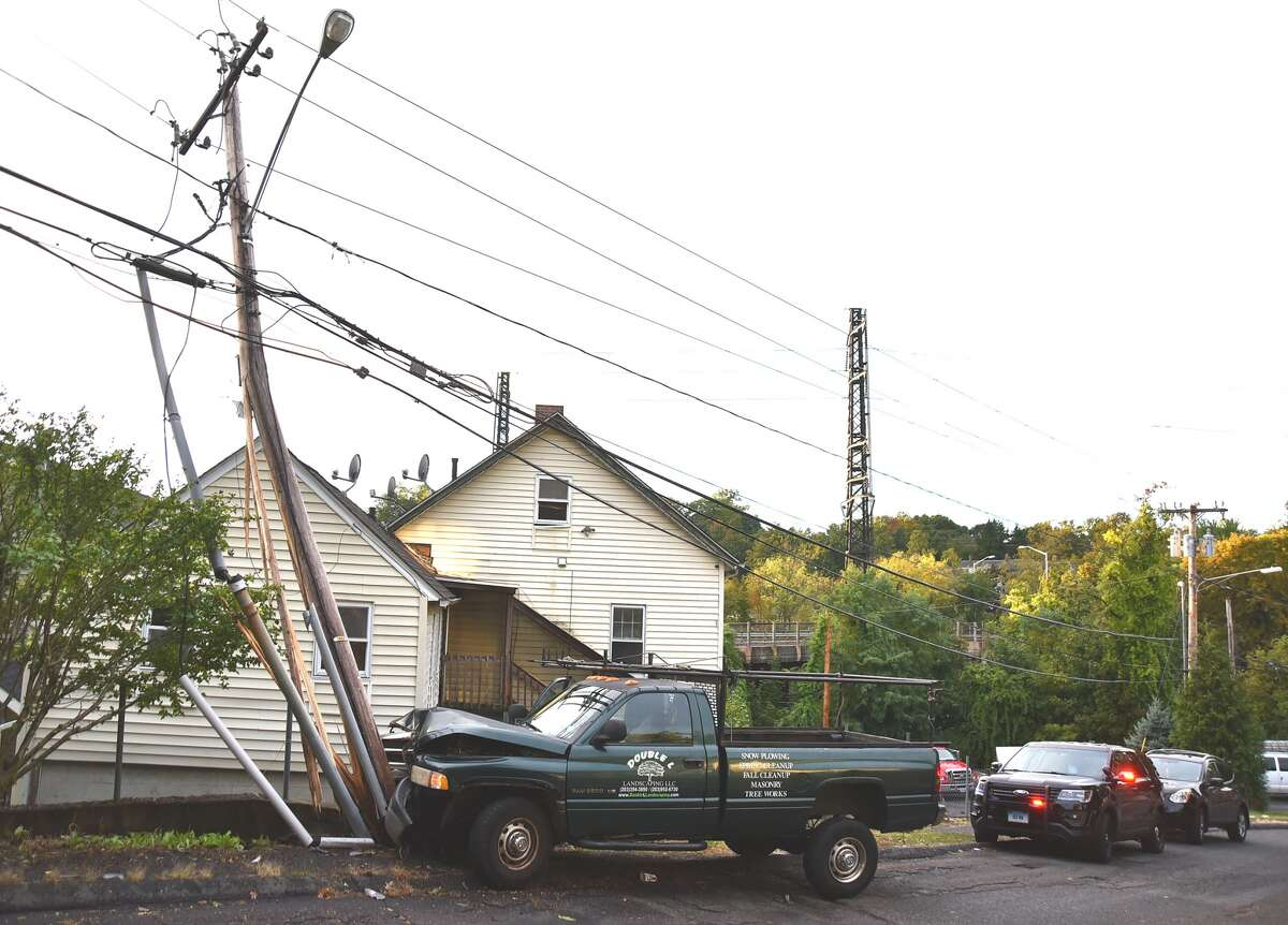 Police said three people fled from a pickup truck Sunday afternoon after it crashed into utility police on Laura Street.