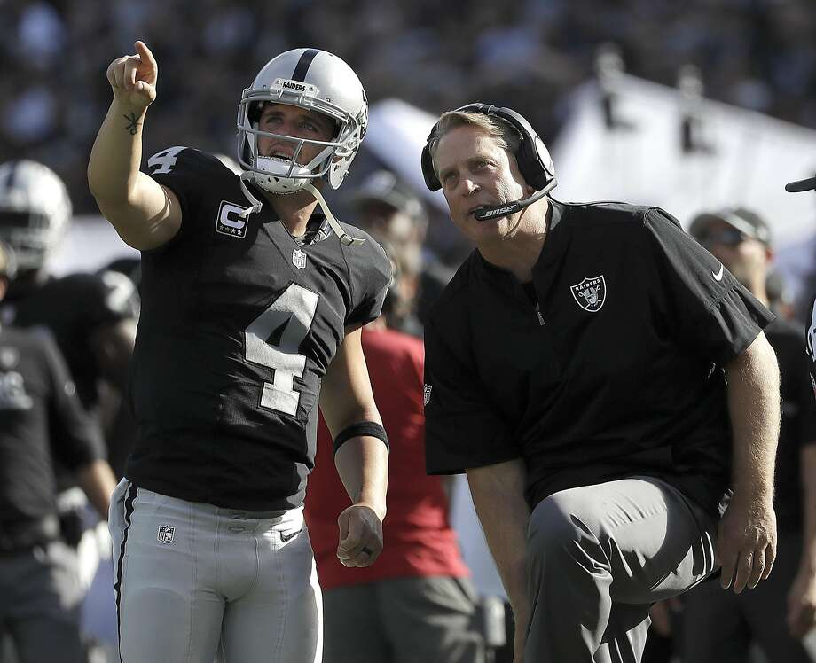 Oakland Raiders quarterback Derek Carr (4) and head coach Jack Del Rio watch a replay during the second half of an NFL football game against the San Diego Chargers in Oakland, Calif., Sunday, Oct. 9, 2016. (AP Photo/Marcio Jose Sanchez) Photo: Marcio Jose Sanchez, Associated Press