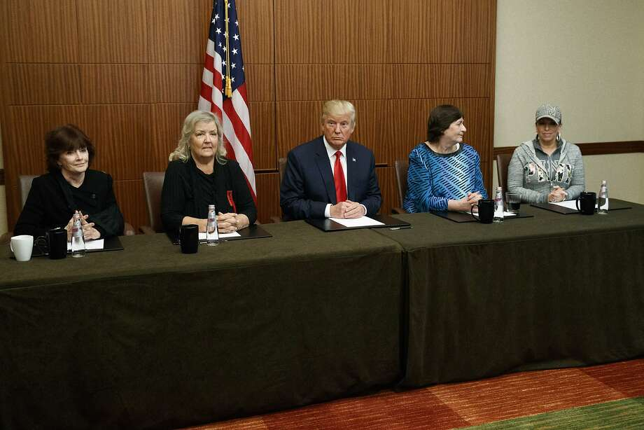 Republican presidential candidate Donald Trump, center, sits with, from right, Paula Jones, Kathy Shelton, Juanita Broaddrick, and Kathleen Willey, before the second presidential debate with Democratic presidential candidate Hillary Clinton at Washington University, Sunday, Oct. 9, 2016, in St. Louis.  (AP Photo/ Evan Vucci) Photo: Evan Vucci, Associated Press