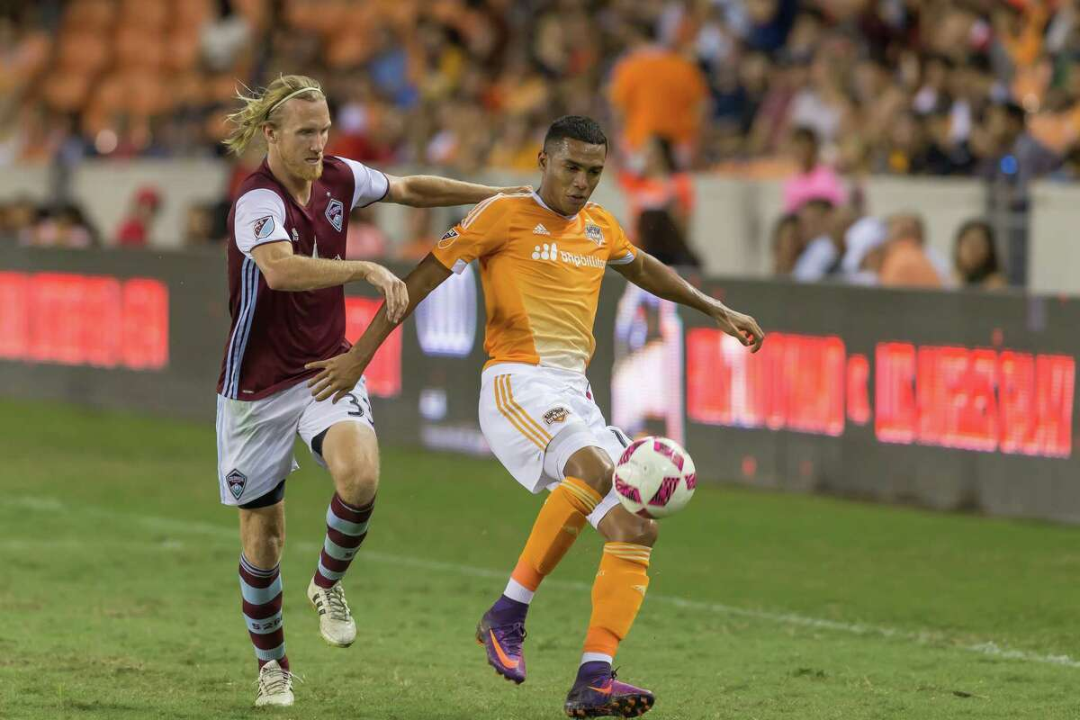 October 8 2016: Colorado Rapids midfielder Jared Watts (33) tries to stop Houston Dynamo forward Mauro Manotas (19) from advancing the ball during the MSL match between the Colorado Rapids and Houston Dynamo at BBVA Compass Stadium in Houston, Texas. (Leslie Plaza Johnson/Chronicle)