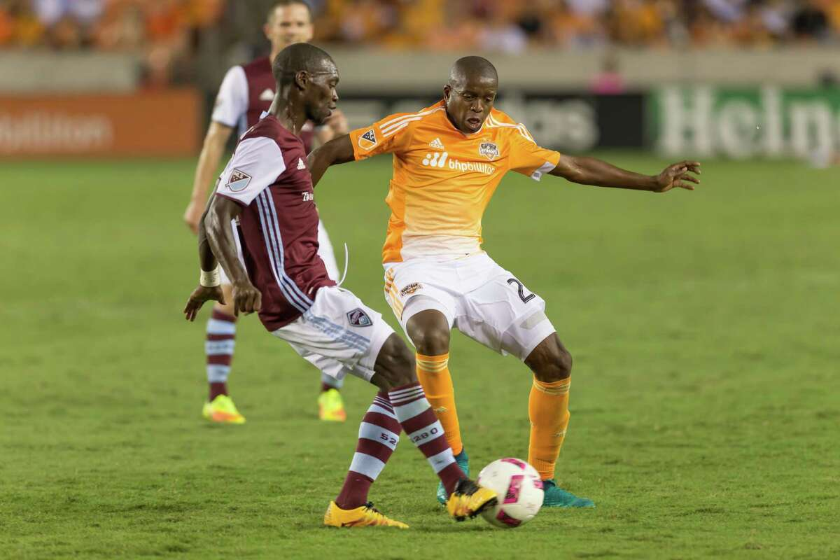 October 8 2016: Houston Dynamo midfielder Oscar Garcia (27) fights for ball during the MSL match between the Colorado Rapids and Houston Dynamo at BBVA Compass Stadium in Houston, Texas. (Leslie Plaza Johnson/Chronicle)