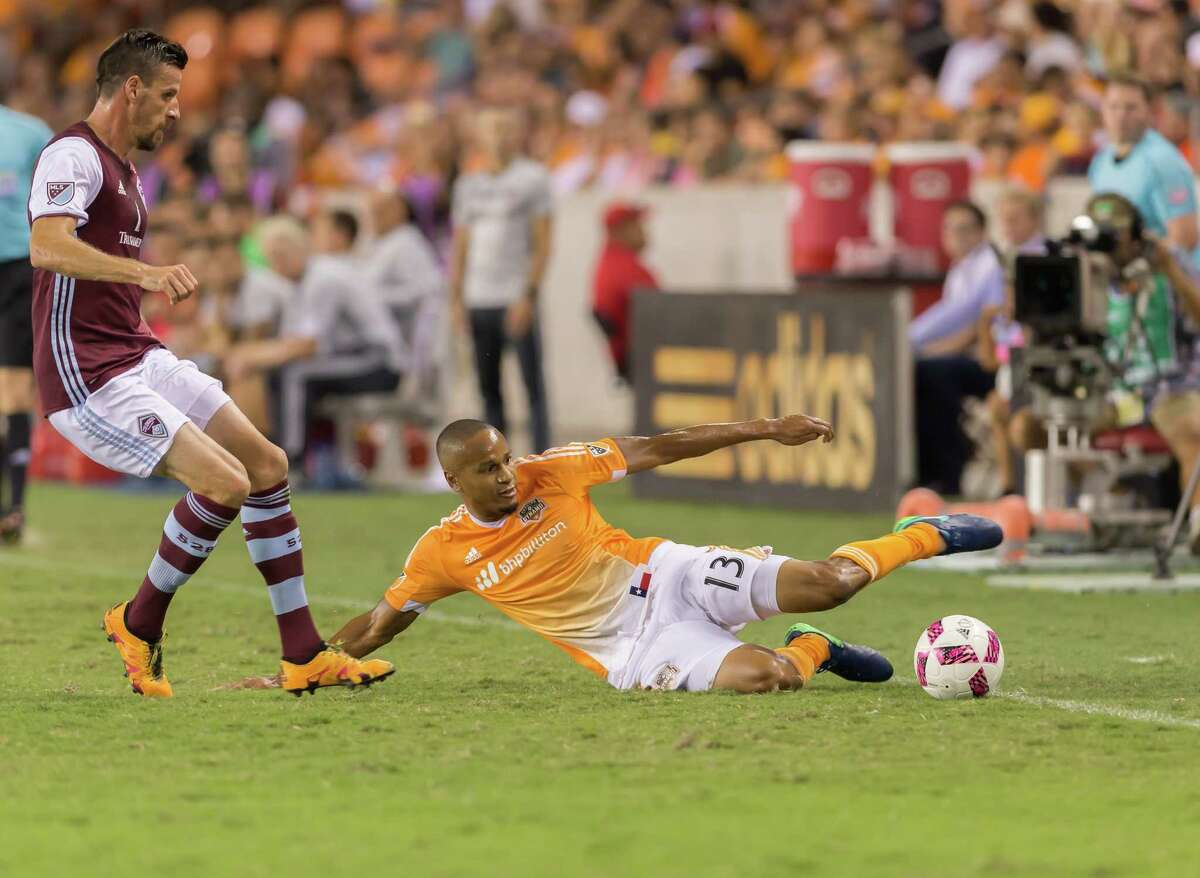 October 8 2016: Houston Dynamo midfielder Ricardo Clark (13) slides to save the ball during the MSL match between the Colorado Rapids and Houston Dynamo at BBVA Compass Stadium in Houston, Texas. (Leslie Plaza Johnson/Chronicle)