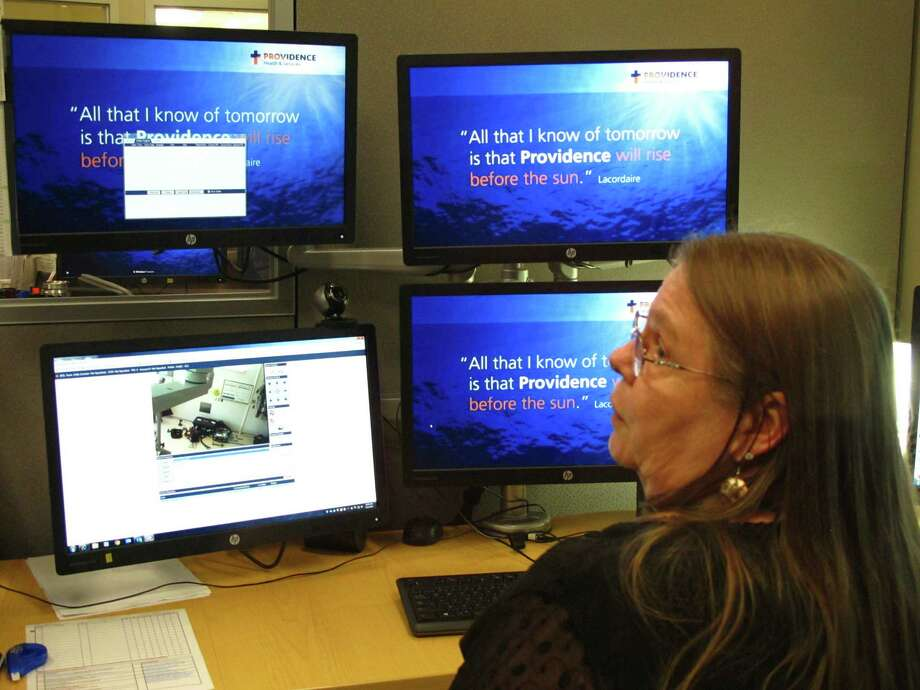 In this photo taken Sept. 13, 2016, intensive care unit nurse Deborah Springer in Anchorage, Alaska, demonstrates the focusing ability of a telemedicine camera that is part of a new telemedicine partnership between the Iliuliuk Family and Health Services on Unalaska Island and Providence Alaska Medical Center. Telemedicine is on the cusp of expanding in Texas, but antiquated regulations stand in the way. (AP Photo/Rachel D'Oro) Photo: Rachel D'Oro, STF / Copyright 2016 The Associated Press. All rights reserved.
