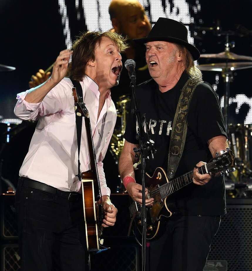 Sir Paul McCartney (L) and Neil Young perform onstage during Desert Trip at the Empire Polo Field on October 8, 2016 in Indio, California. Photo: Kevin Winter, Getty Images