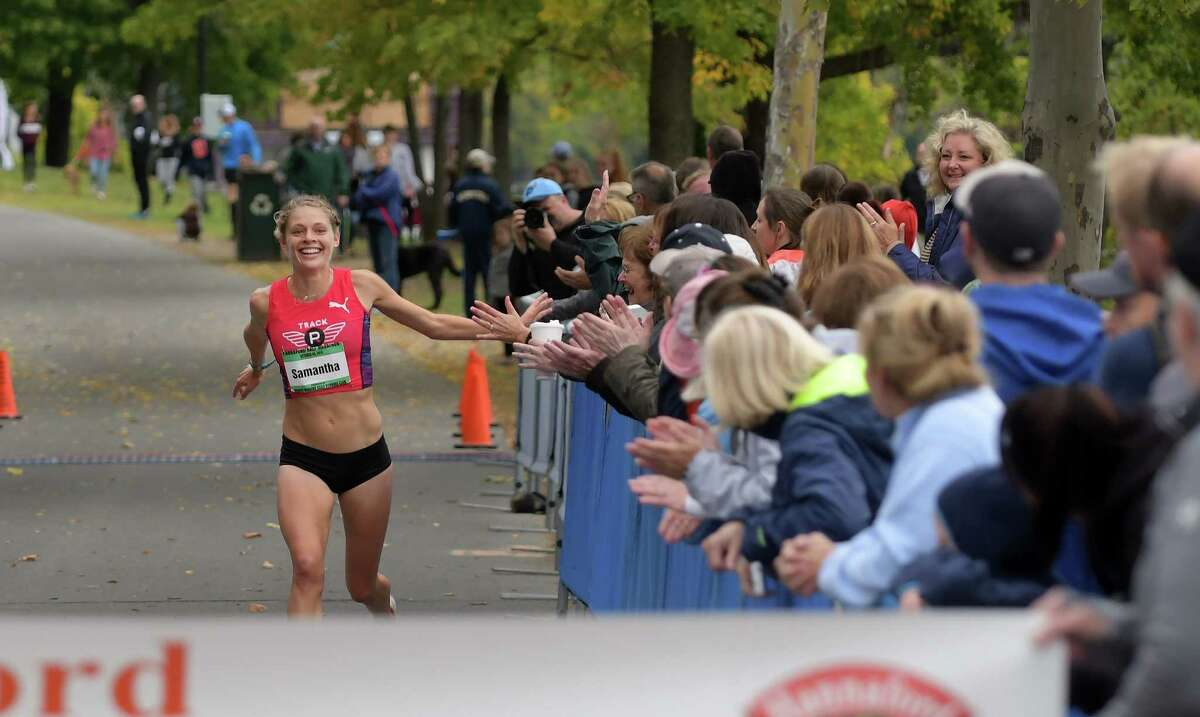 Burnt Hills native, Samantha Roecker, now living in Philadelphia, PA, makes her way towards the finish line to finish first for the women in the Hannaford Supermarkets Half Marathon on Sunday, Oct. 9, 2016, in Albany, N.Y. The half marathon is held along with the Mohawk Hudson River Marathon. (Paul Buckowski / Times Union)