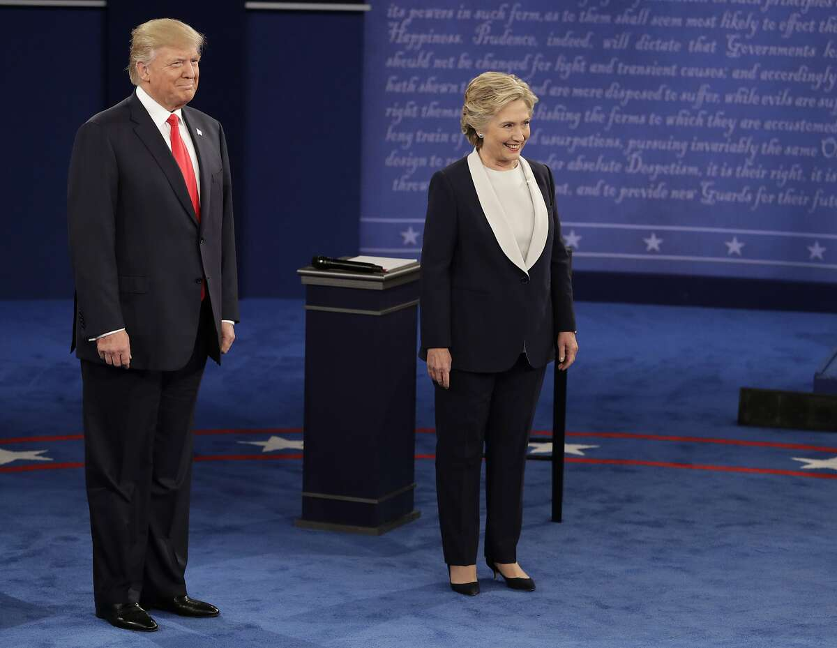 Republican presidential nominee Donald Trump and Democratic presidential nominee Hillary Clinton arrive for the second presidential debate at Washington University in St. Louis, Sunday, Oct. 9, 2016.