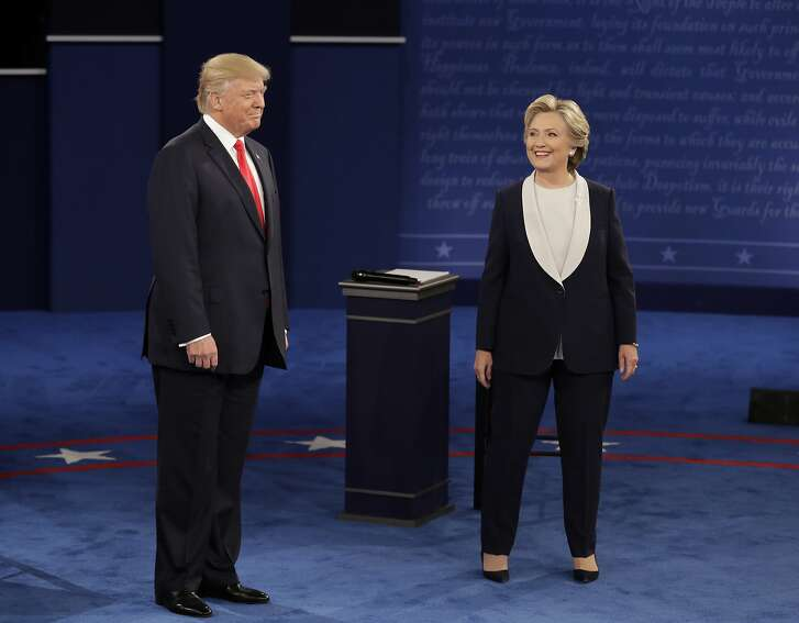 Republican presidential nominee Donald Trump and Democratic presidential nominee Hillary Clinton arrive for the second presidential debate at Washington University in St. Louis, Sunday, Oct. 9, 2016.  (AP Photo/John Locher)