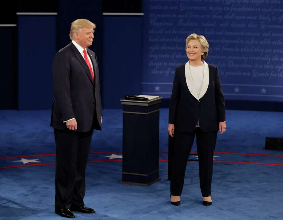 Dozens of Houston residents turned out to watch the second presidential debate at area bars. Here is some of the thoughts they shared while watching. Photo: John Locher, Associated Press / Copyright 2016 The Associated Press. All rights reserved.