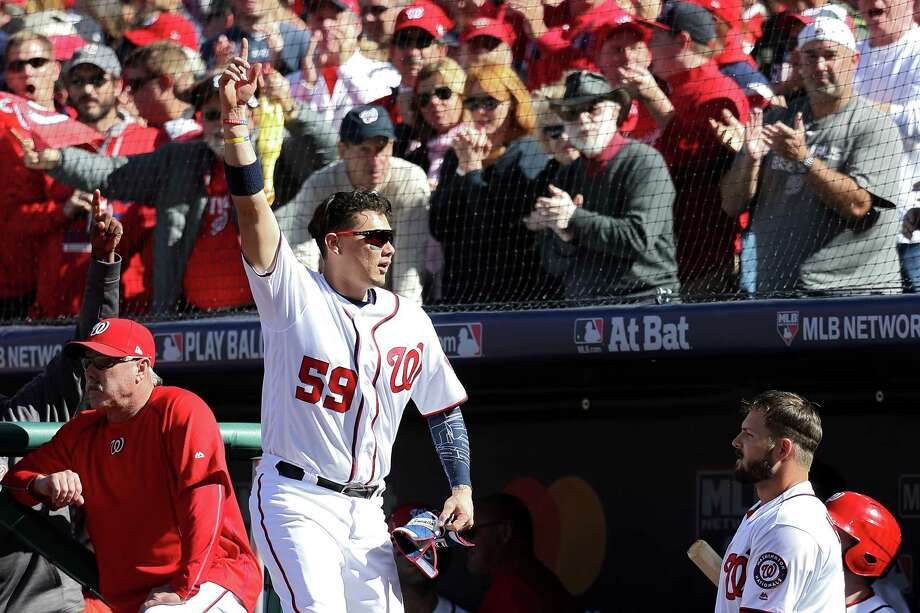 The Nationals' Jose Lobaton makes a curtain call after his three-run homer in the fourth. Photo: Rob Carr, Staff / 2016 Getty Images