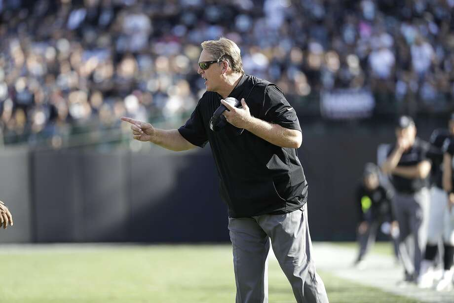 """I love that he believes in us,"" Derek Carr said of head coach Jack Del Rio (above) after Sunday's game . ""I'm staring to think like him. We're getting on the same page. Which is cool."" Photo: Marcio Jose Sanchez, Associated Press"