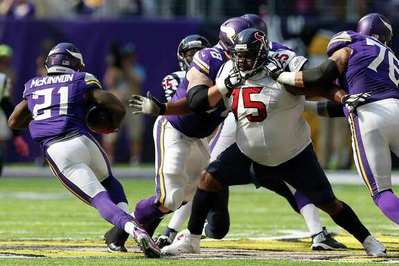 Vikings running back Jerick McKinnon (21) cuts away from Texans nose tackle Vince Wilfork (75) during the fourth quarter.  McKinnon carried 20 times for 36 yards.