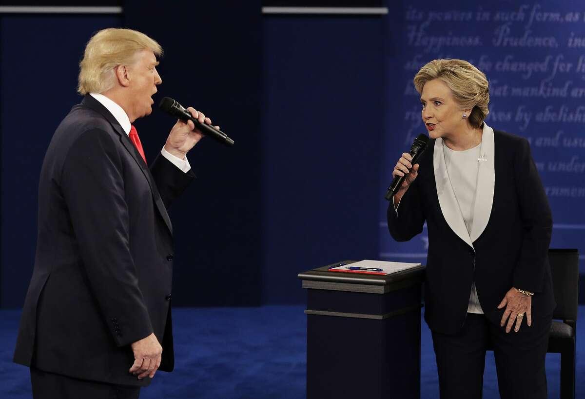 Republican presidential nominee Donald Trump and Democratic presidential nominee Hillary Clinton speak during the second presidential debate at Washington University in St. Louis, Sunday, Oct. 9, 2016. (AP Photo/John Locher)