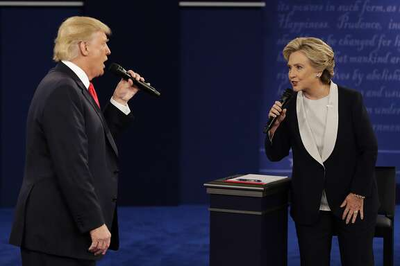 Republican presidential nominee Donald Trump and Democratic presidential nominee Hillary Clinton speak during the second presidential debate at Washington University in St. Louis, Sunday, Oct. 9, 2016. (AP Photo/John Locher)