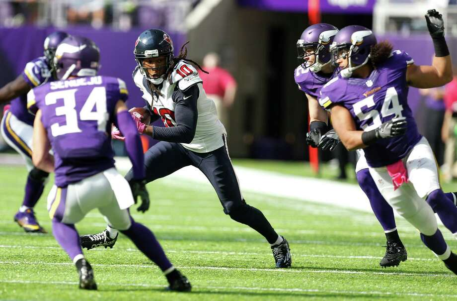 Texans receiver DeAndre Hopkins (10) finds a rare seam against the Vikings on Sunday at U.S. Bank Stadium. He netted 25 yards on this pass play but only 31 more for the game. Photo: Brett Coomer, Staff / © 2016 Houston Chronicle