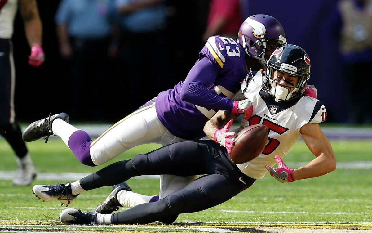 Vikings cornerback Terence Newman (23) breaks up a pass intended for Texans rookie wideout Will Fuller, who had just one reception for 4 yards Sunday.