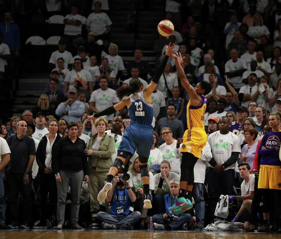 Los Angeles' Alana Beard, right, hits the game-winning shot at the buzzer over Minnesota's Maya Moore to lift the Sparks to victory in Game 1 of the WNBA Finals. Photo: Jeff Wheeler, MBR / Minneapolis Star Tribune