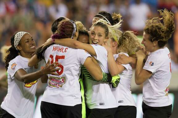 The Western New York Flash celebrate their win over the Washington Spirit after forward Lynn Williams secured the game with a penalty kick in the shootout Sunday.