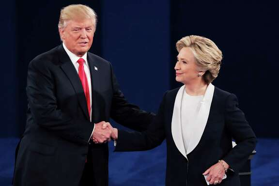 After not shaking hands at the introduction, Donald Trump and Hillary Clinton do so after a rancorous debate Sunday in St. Louis.