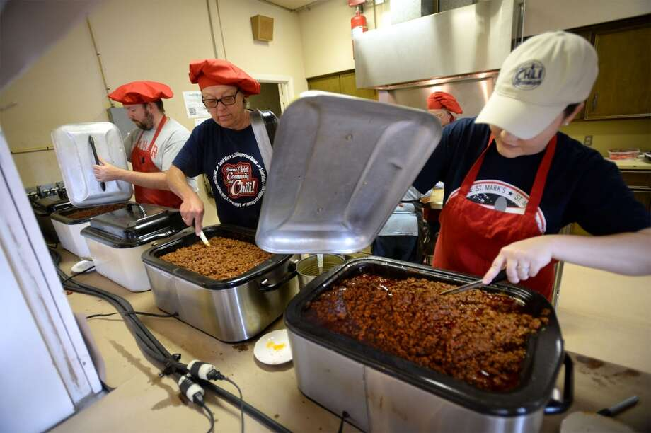 From left, Charles Teel, Kelly Munro and Erin Williamson stir batches of chili Tuesday for St. Mark's Episcopal Church's annual chili fundraiser. In a 12 week period, volunteers make about 3,240 quarts of chili to raise money for area charities.   Photo taken Tuesday, September 27, 2016 Guiseppe Barranco/The Enterprise Photo: Guiseppe Barranco/The Enterprise