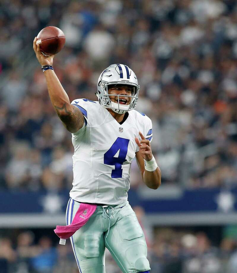 Dallas Cowboys quarterback Dak Prescott (4) throws for a touchdown against the Cincinnati Bengals in the first half on Sunday Oct. 9, 2016 at AT&T Stadium in Arlington, Texas. Photo: Brad Loper, TNS / Fort Worth Star-Telegram