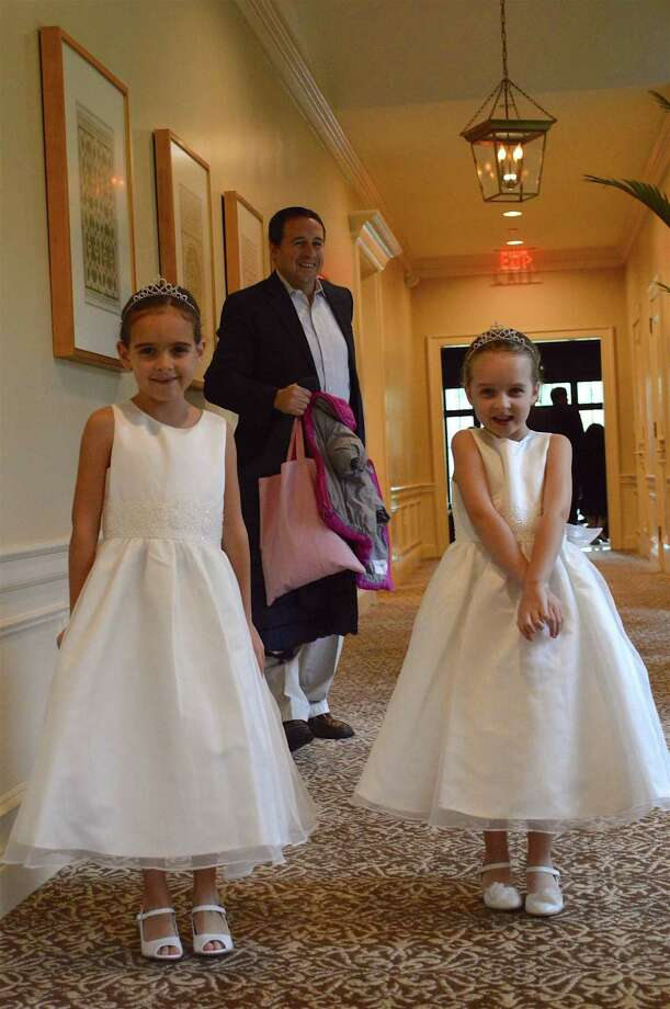 Jason Caamano of New Canaan and his daughters, Bella, 7, left, and Katie, 6, arrive at the New Canaan Father-Daughter Dance, Sunday, Oct. 9, 2016,  at the Woodway Country Club in Darien, Conn. Photo: Jarret Liotta / For Hearst Connecticut Media / New Canaan News Freelance
