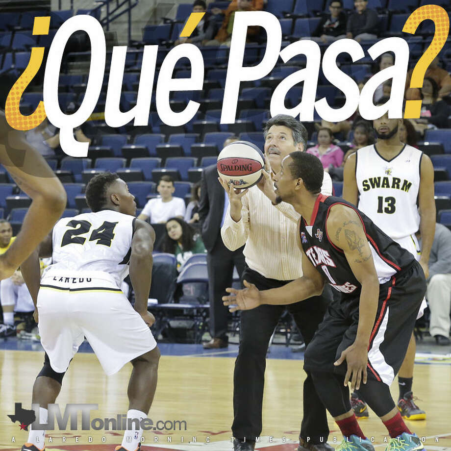 City of Laredo Mayor Pete Saenz, center, prepares to throw the tip off ball Sunday evening during Laredo Swarm's debut home game against the Texas Red Wolves at the Laredo Energy Arena.