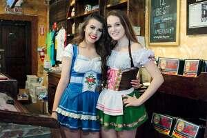 King's Biergarten hosteses wear traditional dirndl style dresses at  Oktoberfest Saturday, Oct. 8.