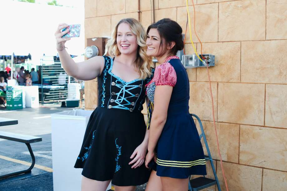 Partiers take time for a quick selfie in their German-inspired attire at King's Biergarten Oktoberfest Saturday, Oct. 8, 2016. Photo: Kirk Sides/Pearland Journal