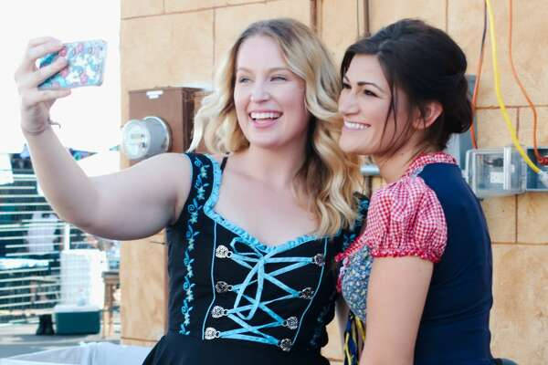 Jackie and Kelly take time for a quick selfie in their tradition German attire at King's Biergarten Oktoberfest Saturday, Oct. 8.