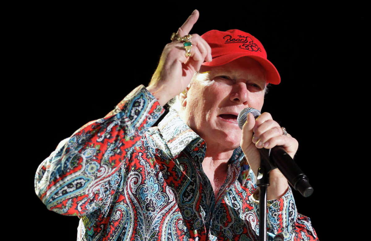 FILE - In this June 26, 2012, file photo, Mike Love performs with The Beach Boys at the Bank of America Pavilion in Boston. People magazine reports Love detailed a 1968 encounter with cult leader Charles Manson in a new memoir set for release in Sept. 2016. (AP Photo/Michael Dwyer, File)