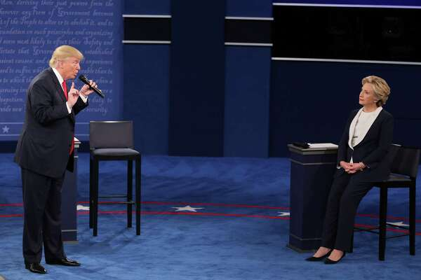 Donald Trump speaks as Hillary Clinton sits during the second U.S. presidential debate at Washington University in St. Louis, Missouri on Sunday. The debate was contentious.