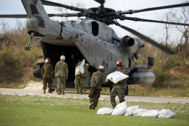 U.S. soldiers unload foods from a helicopter in Jeremie, Haiti, Sunday, Oct. 9, 2016. Aid has begun pouring into the hard-hit town, where thousands of homes were damaged or destroyed and many people were running low on food and facing an increased risk for cholera. (AP Photo/Dieu Nalio Chery)