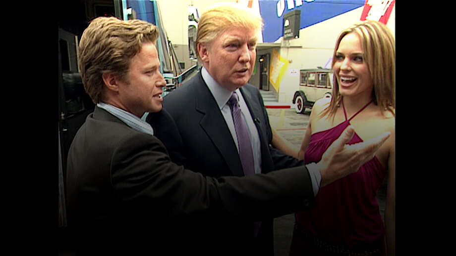 In this 2005 frame from video, Donald Trump prepares for an appearance on 'Days of Our Lives' with actress Arianne Zucker (right). He is accompanied to the set by Access Hollywood host Billy Bush (left). (Obtained by The Washington Post via Getty Images) Photo: The Washington Post/The Washington Post/Getty Images