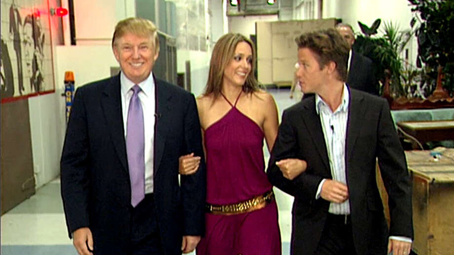 VIDEO FRAME GRAB: In this 2005 frame from video, Donald Trump prepares for an appearance on 'Days of Our Lives' with actress Arianne Zucker (center). He is accompanied to the set by Access Hollywood host Billy Bush. (Obtained by The Washington Post via Getty Images) Photo: The Washington Post/The Washington Post/Getty Images