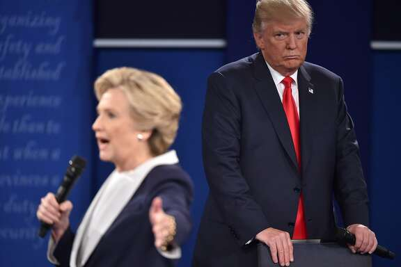 TOPSHOT - Republican presidential candidate Donald Trump listens to Democratic presidential candidate Hillary Clinton during the second presidential debate at Washington University in St. Louis, Missouri on October 9, 2016. / AFP PHOTO / Paul J. RichardsPAUL J. RICHARDS/AFP/Getty Images