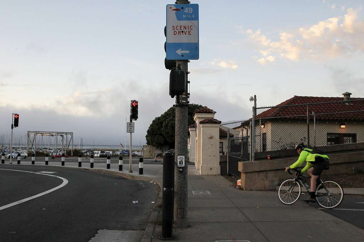 A biker passes by the Historic 49 Mile San Francisco Fort Mason route sign at Laguna St. and Marina Blvd on Sunday, Oct. 9, 2016 in San Francisco, Calif.