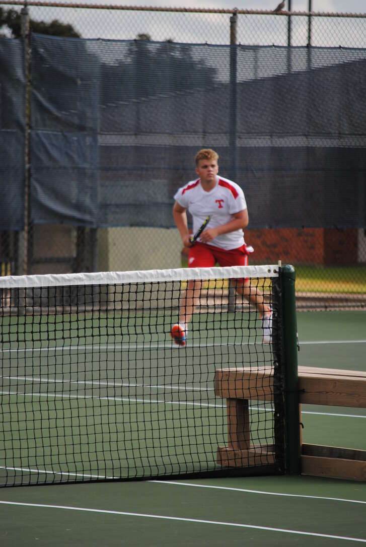 Tomball's Grant Sumner and the Cougars are competing with Tomball Memorial for a district team tennis title.