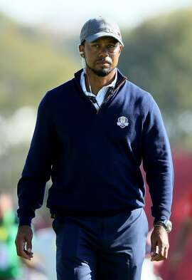 CHASKA, MN - SEPTEMBER 30:  Vice-captain Tiger Woods of the United States looks on from the ninth hole during afternoon fourball matches of the 2016 Ryder Cup at Hazeltine National Golf Club on September 30, 2016 in Chaska, Minnesota.  (Photo by Andrew Redington/Getty Images)
